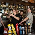 IndyCar drivers show off their skills behind the bar: Slideshow