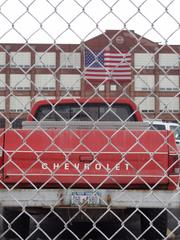 Two iconic American brands: Remington Arms, and Chevrolet. A photo of the employee parking lot at Remington's main entrance.