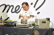Emeril Lagasse whips up a dish during his cooking demonstration at Belk's store in SouthPark.