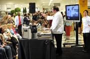 Emeril Lagasse offers tips at Belk's cooking demonstration Wednesday.