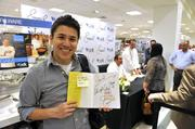 Daniel Valverde of Charlotte was among those who got a signed cookbook.