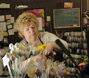 Denise Grzella arranges flowers at Mohawk Valley Florist & Gift.