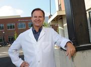 Dr. Steve Cleves, a 1984 Xavier University alum is president of Queen City Physicians, a TriHealth medical group that's based in Hyde Park. The group began operating at University Station on Monday.