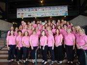 The Friends of Costco Guild is 26 years old and to date has raised more than $80 million for uncompensated care at Seattle Children's Hospital. Here they pose at Safeco Field on Aug.18, the night of the dinner capping a three date event that raised $7.2 million for Children's.