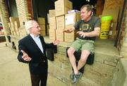 Former Pittsburgh Mayor Tom Murphy, left, talks with David Kalla, co-owner of A.D. Starr, at the loading dock of the South Side-based sporting goods company.