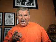 "A vision in orange, former Chicago Bears head coach Mike Ditka is heard loud and clear in the new ""Bear Down"" TV commercial."