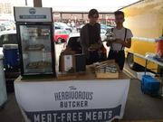 Dan Campbell (left) and Kale Walch (right) at The Herbivorous Butcher's booth at the Minneapolis Farmers Market.
