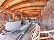 The Globe building features hulking wood beams, dark wood flooring and 43,000 square feet of space.