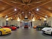 The 16-car garage, with its beamed ceiling, is the centerpiece of this $4 million west Bellevue home which went on the market less than two weeks ago.