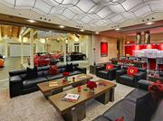 In this $4 million Bellevue house, which is for sale, the family room has full view of the garage and the owners' car collection.