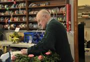 Sam Geloso, owner of Mohawk Valley Florist & Gift. Geloso used to make Remington typewriters before opening his florist shop.