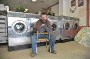 Adam Waldo, 30, manages a laundromat in Ilion. His father has been a foreman at the Remington Arms plant for 30 years.
