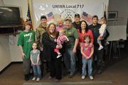 """A family forged by Remington: The Browns. The nexus is Frank """"Rusty"""" Brown (center, in hat and green shirt), who is a furnace technician at Remington Arms and past union president there. His parents, his wife, his two daughters and his step-son all work at Remington."""