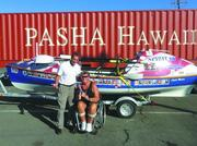 Pasha Hawaii Regional Manager Reggie Maldonado and Angela Madsen, Guinness World Records ocean rower, pose for a photo. Madsen set out from Long Beach, California, with Tara Remington of New Zealand, rowing the 19-foot Spirit of Orlando more than 2,500 miles to Honolulu. Sixty days later, without a support boat, they landed in Waikiki. Madsen, a paraplegic who was injured while on duty as a Marine, rowed to raise funds for California Adaptive Rowing Programs to purchase new boats for its aging fleet and to recognize fallen soldiers with a military and veteran tribute row. Pasha Hawaii became a sponsor to assist Madsen in shipping the boat back to California.