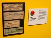 The Maryland Lottery exhibit at Baltimore Museum of Industry showcases the history of the lottery, including items such as early lottery tickets before the agency was established.
