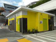 An exterior shot of the SAGE green portable classroom demonstrates its sleek look.