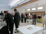 PSU President Wim Weiwel (center) visits with other dignitaries during a showing of the SAGE green modular classroom prototype.