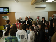 Margarette Leite (far left) addresses students and others in one of the SAGE team's prototype classrooms.