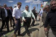 Prince Harry of Wales, left, and Chris Christie, governor of New Jersey, view areas of the boardwalk in Seaside Heights, N.J., on Tuesday. Seaside Heights Mayor William Akers is looking forward to showing off the improvement as the prince visits, part of a week-long U.S. tour that also includes stops in Washington, Colorado and New York.
