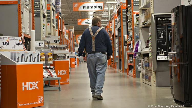 A customer walks inside at a Home Depot store in Peoria, Illinois.