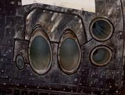 Scorches remain inside the directional thrusters. Burn marks help tell the story of re-entry.