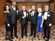 From left, William Jews of Choice Hotels International Inc. and his wife, John Haley of Towers Watson, George Clancy of WGL Holdings Inc. and Washington Gas with his wife, and Larry Besterman, at the 2013 Outstanding Directors Awards.