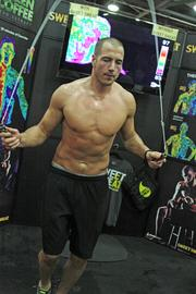 An exhibitor demonstrating fitness.