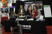 Altres personnel assistants Heather Massetti, center, and Janna Vient, right, answer questions from job seekers.