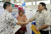 Jeremy Yasutake, left, of Aerotek, introduces himself to job applicant Michael Piccinino as Rona Augustine Chun, director of programs for Med-Assist School of Hawaii, looks on.