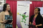 Bishop & Co. technical recruiter Rebekah Ellis, left, and human resources/payroll specialist Annette Waiau review applications submitted by job seekers.