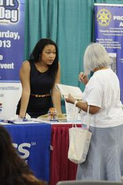 Tini Tauvela Lewis, left, employment manager for Express Employment Professionals, talks with a potential job applicant.