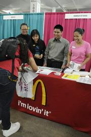 From left, Fua Kokdokmai, Ronalei Tagama, Dharyl Bong Bonga, and Charita Ishii of McDonald's Hawaii talk with an applicant who is interested in applying for work with McDonald's.