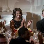 Newsmakers: Fed prez talks, Oprah gets Michelle, girls cool on IT