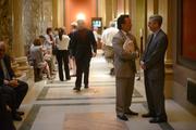 James Clark of Messerli and Kramer (lobbyist) talks with Sen. David Hann (right) outside of the Senate.