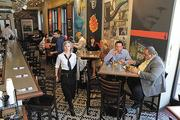 """Taste of Belgium's Belgian Bistro is at 1133 Vine St. Diners chow on waffles, crepes and specialties like boulets Liegeois, frites and its """"Waffle n' chicken."""""""