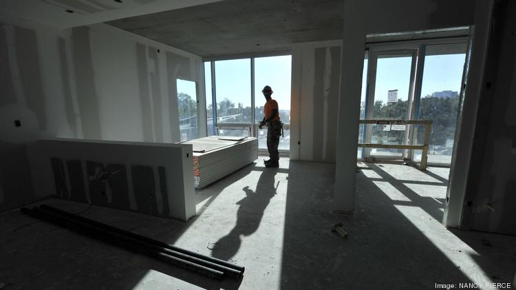 A Worker Installs Drywall In A Corner Unit At The Luxury Skyhouse Apartments  In Uptown Charlotte