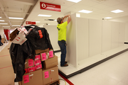 Scott Wesseler of Taylor Brother Construction Co. Inc. of Columbus, Ind. installs a display system at Portland's first CityTarget.