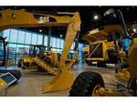 Caterpillar's profits beat Street, raises forecast