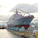 The draft bill that approves Pentagon spending decisions includes littoral combat ship, destroyer and amphibious transport