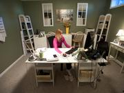 Sheri Scott has created a private office for herself in her basement where she works for Automatic Data Processing Inc. (ADP)