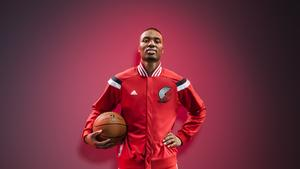 The warm-ups include an enlarged NBA on the hip of the jacket. Pictured, Trail Blazers guard and Adidas endorser Damian Lillard.