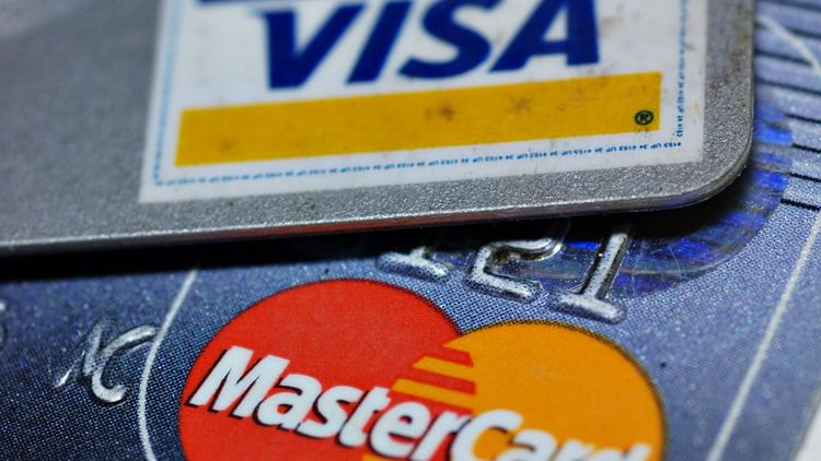 Visa mastercard reach 62b settlement new york business journal mastercard and visa logos are pictured on credit cards in new york wednesday august reheart Choice Image