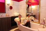 Birchwood Inn co-owner Chuck Prather in a replica claw foot bathtub.
