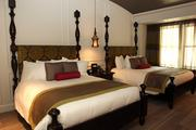 This is what a double room looks like, complete with four-poster bed and high ceiling.