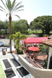 A view of St. Petersburg's Straub Park and restaurants from the second floor.