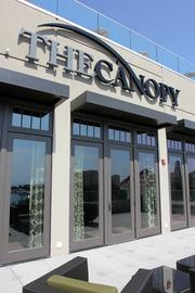 The canopy is a rooftop deck with fire elements, canopies, and a bar and lounge area.