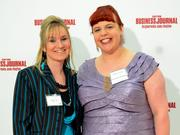 40 Under 40 winner Heather Boehmer (left) and Candy Settle with CareSource