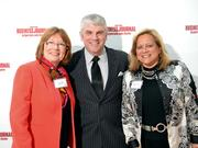 Montgomery County Commissioners Judy Dodge and Debbie Lieberman pose with Dan Edwards.