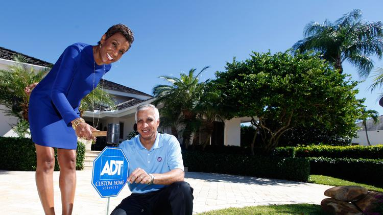 Adt Cmo Jerri Devard And Ceo Naren Gursahaney Plant An Yard Sign At The Home