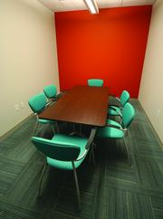 One of two private meeting rooms at The Brix@26 .